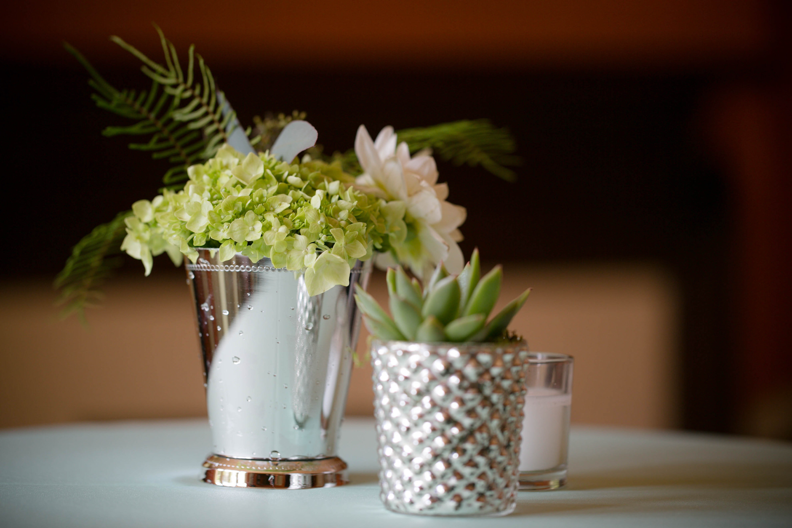 Custom succulent centerpieces at Lauren and Josh's wedding